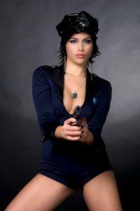 Sexy police woman holding a gun